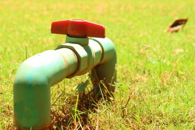 A water pipes on the green grass