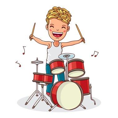 Kid plays the drums