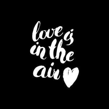 Love is in the air. Watercolor hand drawn black and white lettering