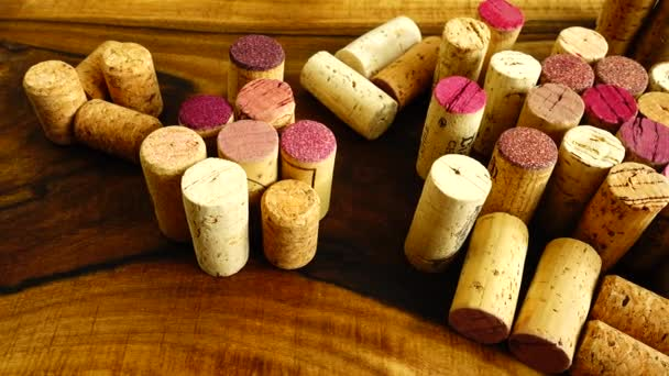 Wine corks on a wooden board.