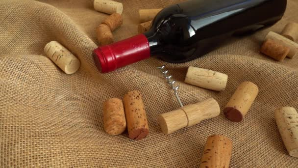 Wine in bottles and falling corks on the bag. Slow motion.