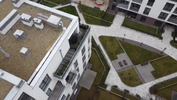 Aerial view of a drone flying over the residential buildings, roof shooting and architecture.