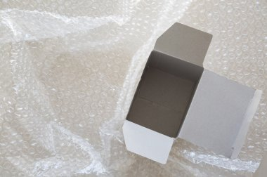 empty white paper box on air bubble background