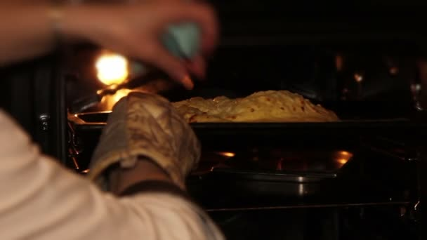 Chef puts bread to the oven