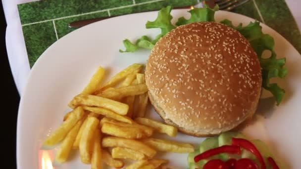 close up of hamburger and french fries on the table