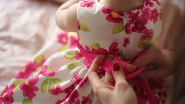 women dressing her baby