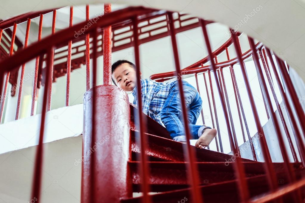 Little Chinese Boy Goes Up The Stairs A Child Playing On The Steep