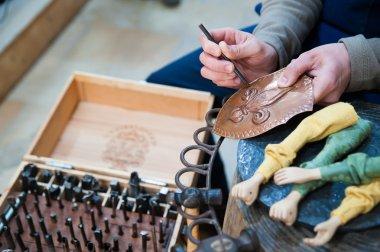 Sicilian puppet artisan at work