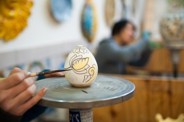Ceramic egg being decorated