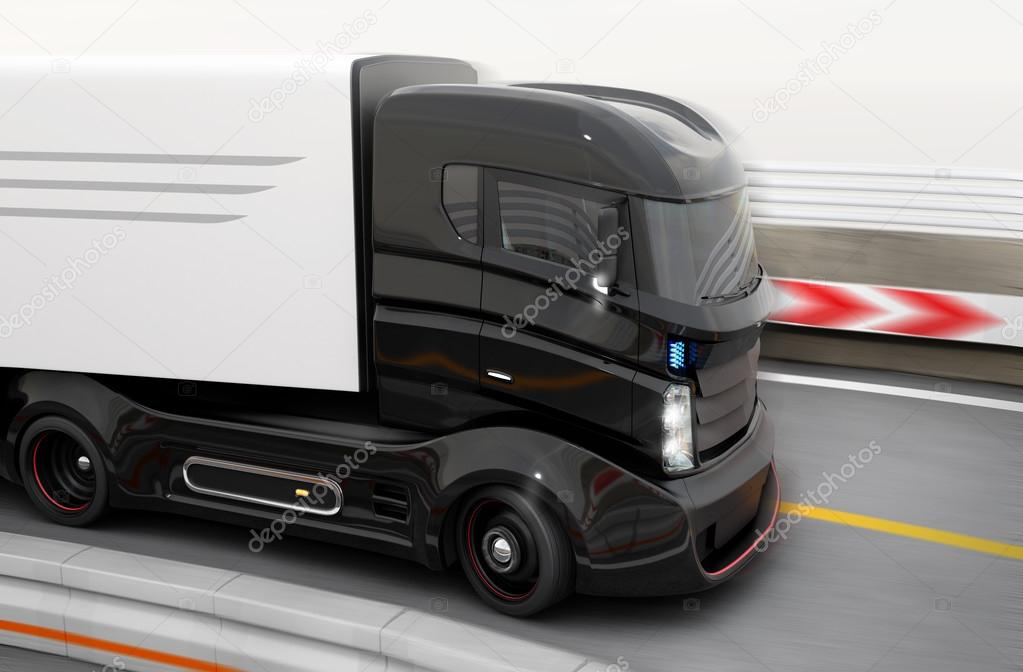 Autonomous hybrid truck driving on highway.