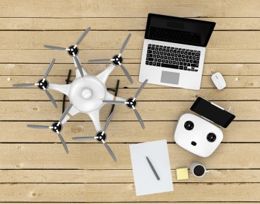 Top view of wood deck, where have hexacopter, remote controller, laptop  on it.