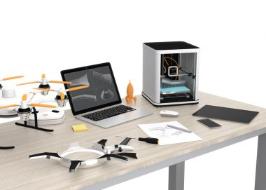 3D printer, laptop, tablet PC and drone on a table