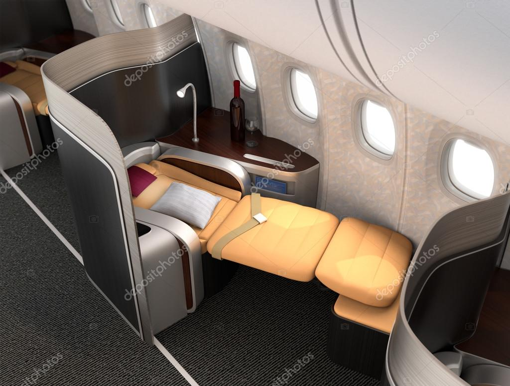 Close-up of luxurious business class seat with metallic silver partition.