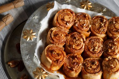 Cinnamon rolls with caramel and nuts decoration