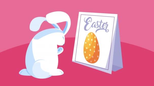 Frohe Ostern Schriftzug in Banner mit niedlichen Kaninchen