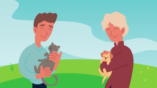Männer mit Katzen- und Hundemaskottchen auf dem Feld