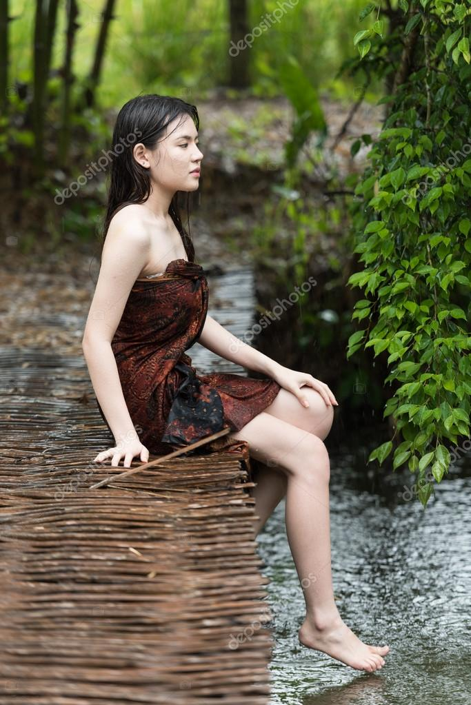 Asian woman taking bath outdoor — Stock Photo © chanawit ...