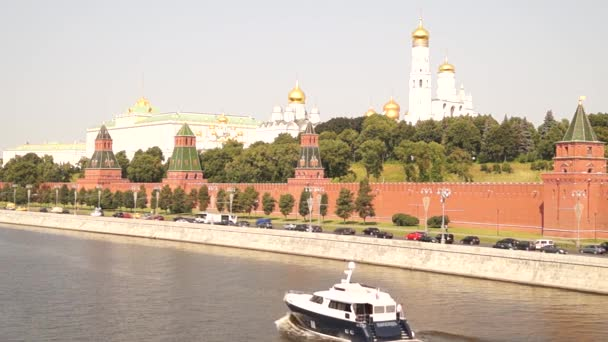 View of the Kremlin Embankment and Kremlin from the Great Moscow River bridge.