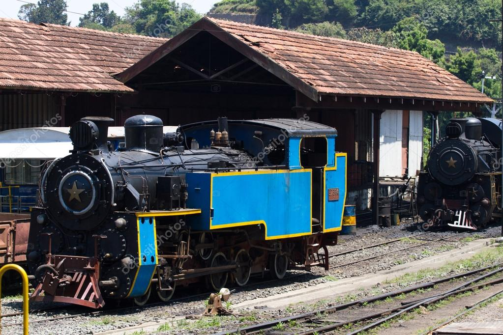 OOTY, TAMIL NADU, INDIA, 22 March 2015 : Nilgiri mountain railway. Blue train. Unesco heritage. Narrow-gauge. Steam locomotive in depot