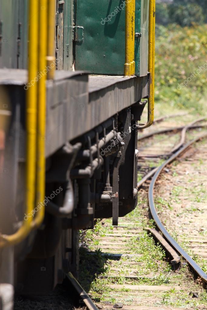 Nilgiri Mountain Railway. Tamil Nadu state, India. Blue train. Unesco heritage. Narrow-gauge. Part of coach in motion