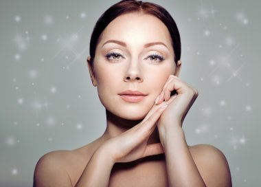 Beautiful Spa Woman Touching her Face. Wintertime