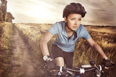 Attractive purposeful in sports equipment active girl riding a r