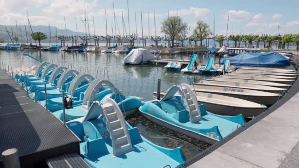 Rapperswil Switzerland april 3, 2021: Blue pedalos in harbor parking lot, daytime sunshine