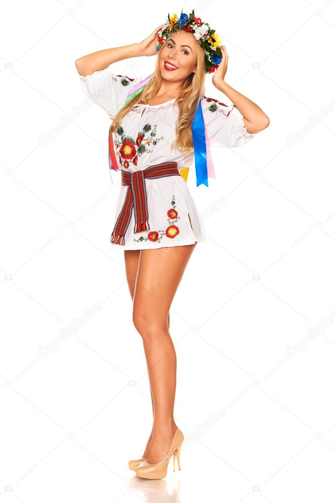 Attractive woman wears Ukrainian national dress isolated