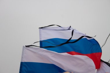 The Russian flag with a mourning black tape