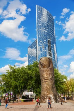 Thumb sculpture from Igor Mitoraj in the financial district La Defense in Paris, France