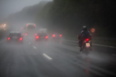 Traffic on a motorway at heavy rain