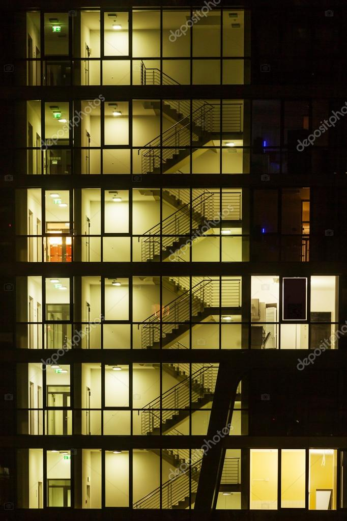 Staircase Of An Apartment Building At Night Stock Photo