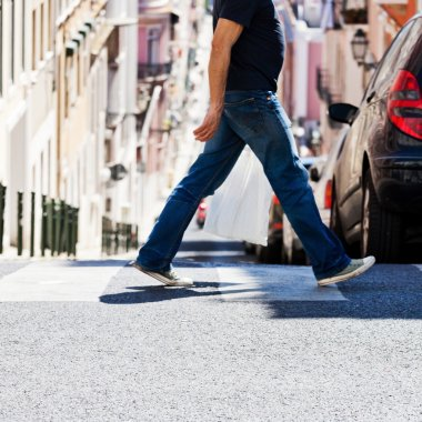 Man crossing a city street