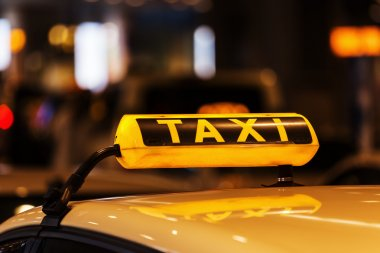 Lighted taxi sign on a roof of a German taxi