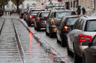 Cars in a traffic jam at rush hour in the rainy city