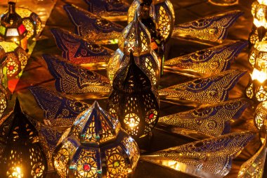 Rows of arabic lanterns with burning candles