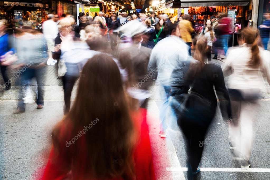 Crowd of people crossing a street