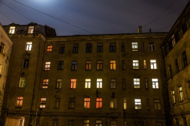 Eerie looking old apartment buildings in Riga, Latvia, at night