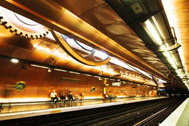 Metro in motion blur at the Arts et Metiers Metro station in Paris, France