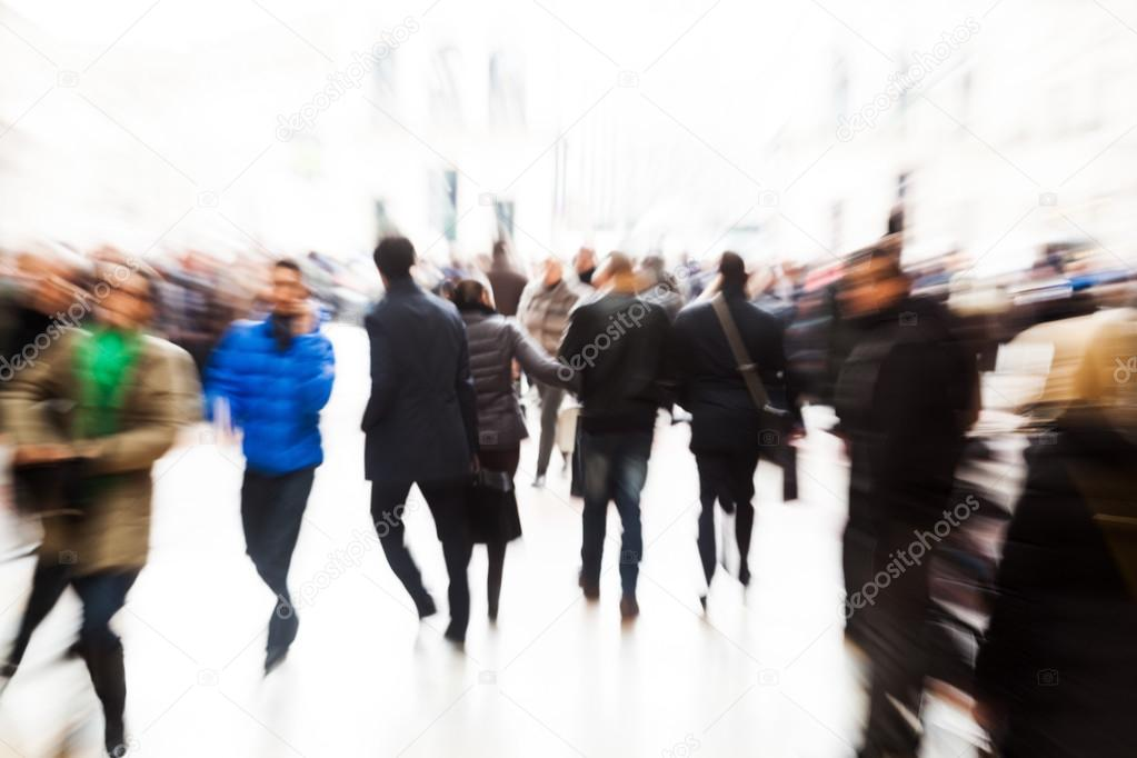 Abstract crowd of people in the city with creative zoom effect