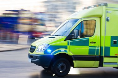 Urgent ambulance in London in motion blur