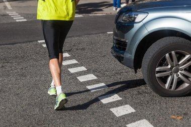 Jogger crossing a street
