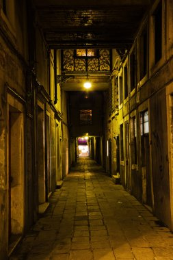 Dark alley in Venice, Italy, at night
