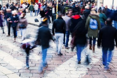 Crowds of people in motion blur in the city