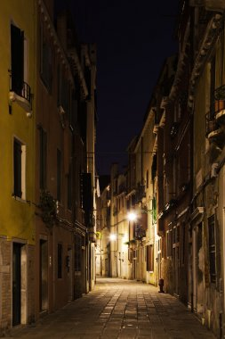 Dark alley in the old town of Venice, Italy, at night