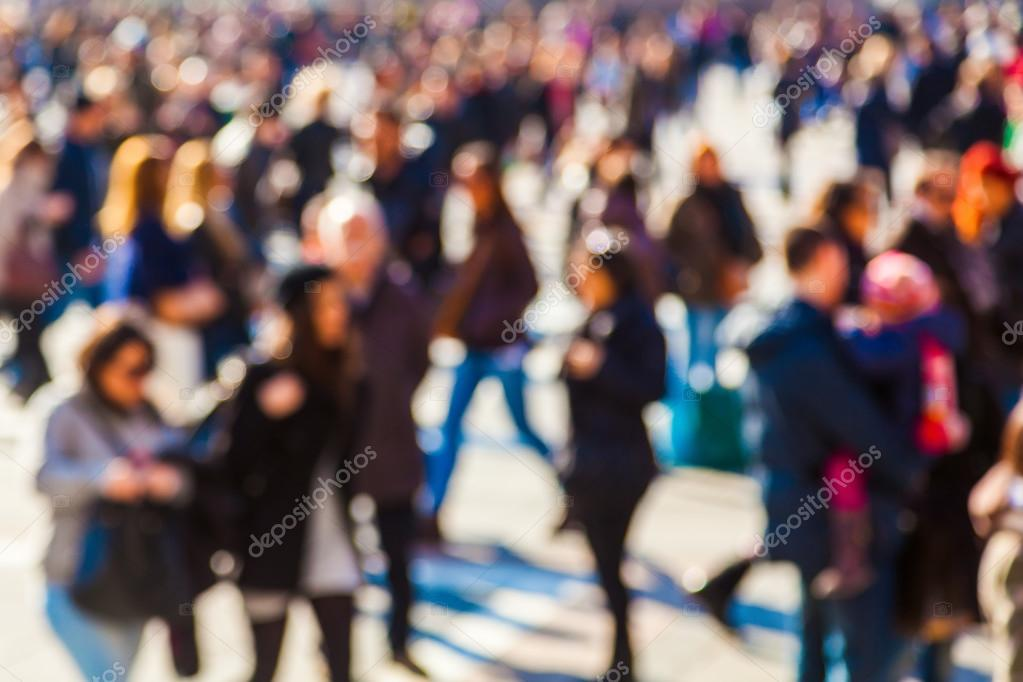 Crowd of people in the city out of focus