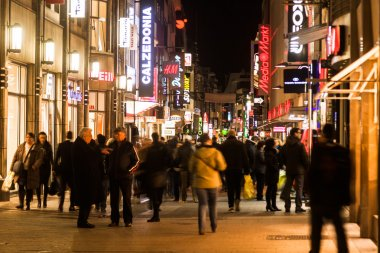 Crowd of people in the shopping street Hohe Straße in Cologne, Germany, at night