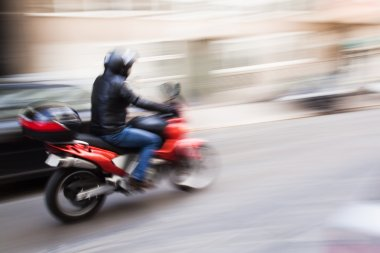 Motorcyclist in motion blur