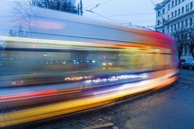 Light trails of a tram in motion blur in the city of Riga, Latvia