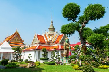Small building nearby the famous Wat Arun Temple in Bangkok, Thailand